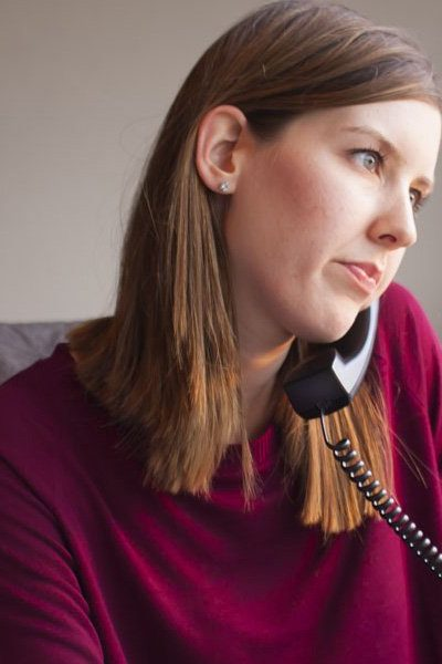 servicexcel employee taking a call in the office